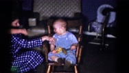 1959: little brother playing with hammer and elder one looks after him CATSKILL Stock Footage