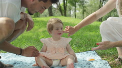 CLOSE UP: Sympathetic caring parents applying sunscreen on soft baby girl's skin Stock Footage