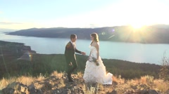 Bride and Groom Kiss on a Mountain Top Sunet Stock Footage