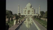 1974: visitors approaching and leaving the taj mahal along reflecting pool Stock Footage