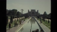 1974: tourists are walking along the shore of the canal before the monument Stock Footage