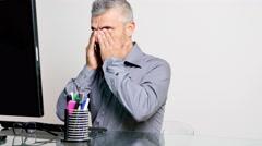 Man having eye pain at computer Stock Footage
