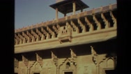 1974: an old woman walking in the courtyard of a large amazing building INDIA Stock Footage