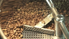 Roasting and mixing coffee at third wave cafe shop, slow motion Stock Footage