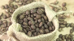 Coffee beans rotating in burlap, close up Stock Footage
