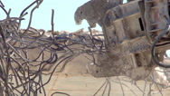Building demolition with a demolition grab close up Stock Footage