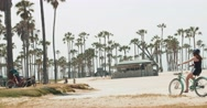 Cycling Along Beach in Venice, California Stock Footage