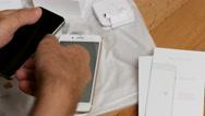 IPhone 7 plus dual camera unboxing insert SIM CARD module Stock Footage