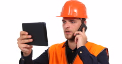 Supervisor Engineer Man Browsing Digital Tablet and Holding Smart Telephone Call Stock Footage
