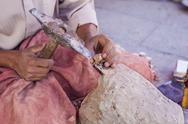 Artisan makes pieces for mosaic craftwork Stock Photos