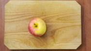 Woman cuts an apple on a wooden board. cooking food Stock Footage