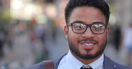 Hispanic Latino man in city face portrait smile happy Stock Footage