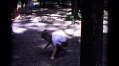 1963: sweeping boy in white shirt on the ground with his hands COLD SPRINGS Stock Footage