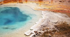 Bright Blue Surface of Boiling Geyser, Yellowstone National Park Stock Footage