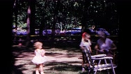 1963: cute kids at the park COLD SPRINGS, NEW YORK Stock Footage