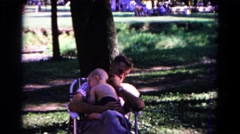 1963: a father with child is seen near a tree COLD SPRINGS, NEW YORK Stock Footage