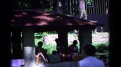 1963: a picnic in a garden area is seen COLD SPRINGS, NEW YORK Stock Footage