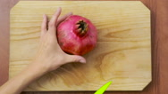 Woman cuts a pear on a wooden board. Stock Footage