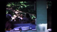 1963: friends and family gather together for a giant meal with barbeque  Stock Footage