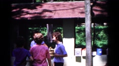 1963: a family including children and teenagers gathered outdoors in the sun Stock Footage