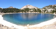 Crystal Blue Lake Surrounded by Ring of Ice & Snow - Lassen Volcanic Park Stock Footage