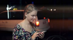 Woman tourist is searching way in navigation via cell telephone, while is Stock Footage