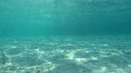 Sandy ocean floor with sunlight through surface Stock Footage