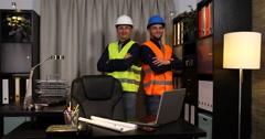 Optimistic Caucasian Engineer Men Look Camera Posing Happy Smiling Presentation Stock Footage