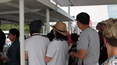 Tourists Disembark from Boat to USS Arizona Memorial at Pearl Harbor Stock Footage