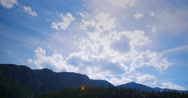 Clouds Time Lapse over Dramatic Mountains Silhouette Stock Footage