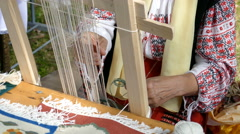 Hands of woman who weave traditionaly at one small loom Stock Footage