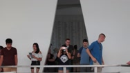 Tourists Soberly File Out of the USS Arizona Memorial Wall Room Stock Footage