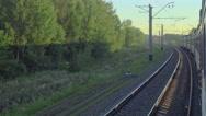 Suburban train at sunset Stock Footage