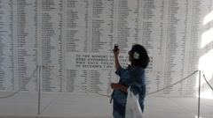Woman Takes Video with Phone of Memorial Wall at USS Arizona, Pearl Harbor Stock Footage