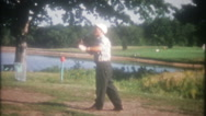 Men play golf at their local course 3660 vintage film home movie Stock Footage