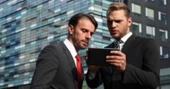 Caucasian Businessmen Using Digital Tablet Urban Scene Teamwork Communication Stock Footage