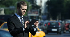 Young Businessperson Working Browsing Digital Tablet Crowded Intersection Day Stock Footage