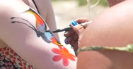 Body Art: Woman Painting Butterfly on Arm Stock Footage