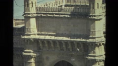 1974: a beautiful historic building set against a scenic river INDIA Stock Footage