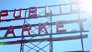 Pike Place Public Market Sign, Downtown Seattle Washington - Panning Shot Stock Footage