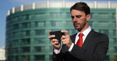 Successful Business Man Sending Message to Partner with Mobile Phone Urban Scene Stock Footage
