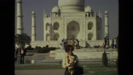 1974: woman wearing sunglasses standing in front of the taj mahal Stock Footage