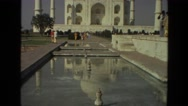 1974: mobile video of taj mahal in india and the pond in front INDIA Stock Footage