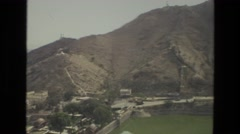 1974: a beautiful mountain ridgeline as seen through a historic site INDIA Stock Footage