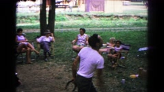 1963: man in t-shirt throws horse shoes with onlookers COLD SPRINGS, NEW YORK Stock Footage
