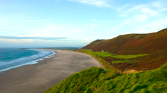View of the beach at Rhossili, Wales Stock Footage