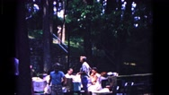 1963: enjoying a meal on a holiday with the family in the countryside  Stock Footage