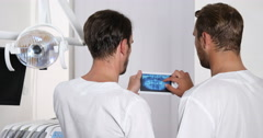Expert Dentist Men Team Checking Radiography Using Digital Tablet Dental Clinic Stock Footage