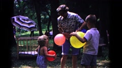 1963: older woman and children holding colorful balloons COLD SPRINGS, NEW YORK Stock Footage