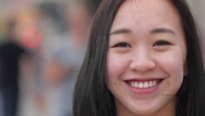 Young Asian woman in city smile happy face portrait close up Stock Footage